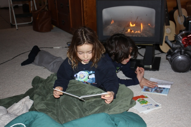 Reading By The Fire After Playing In Their Snow Fort