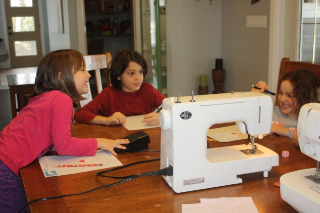They started out learning the parts of the sewing machine. They wrote each new word down.