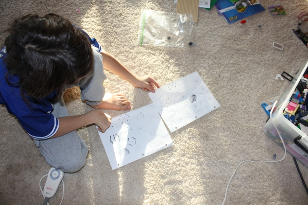 My son drawing out the different ways he sees the dot configuration